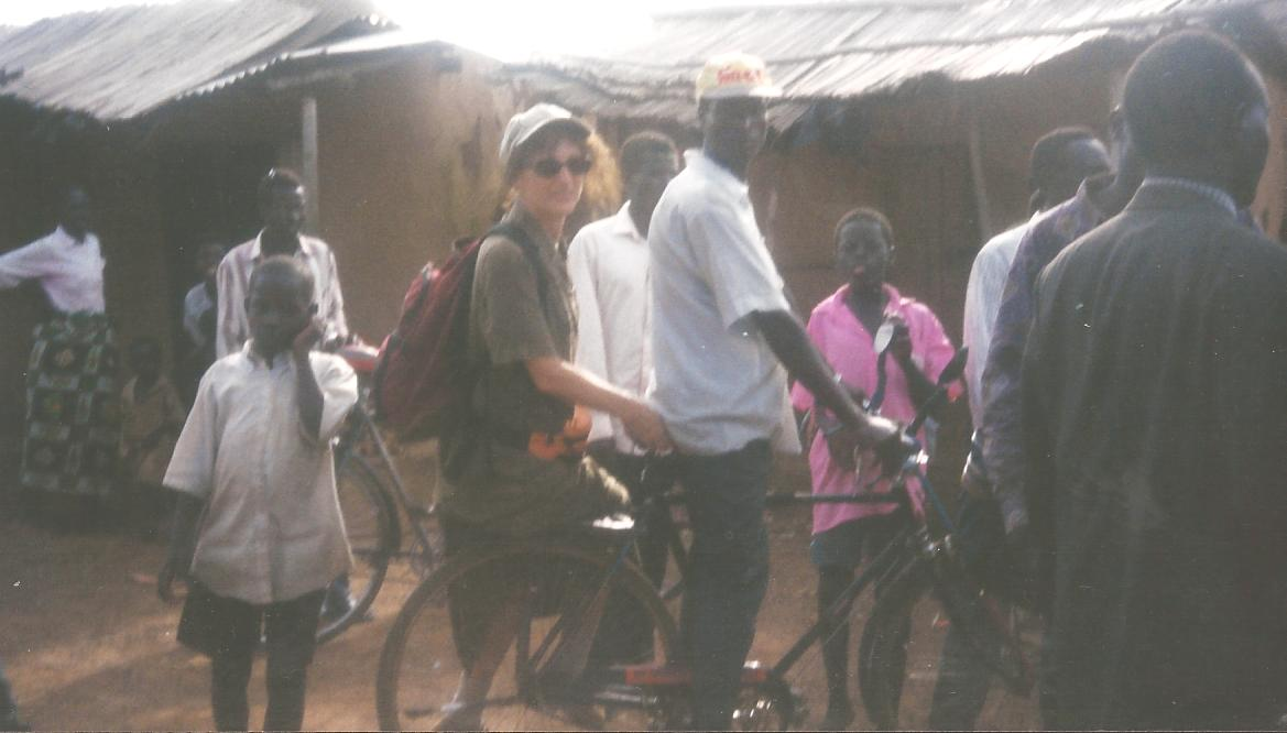 Maura on bike in Africa .jpg